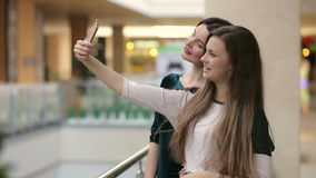 Two women taking a selfie while shopping. stock video footage