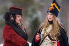 Two women talk Royalty Free Stock Photo