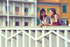 Two Women Talking in the City Royalty Free Stock Images
