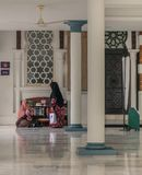 Two women talking in a mosque stock images
