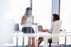 Two women talking in an office Stock Image