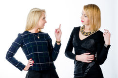 Two women talking, one telling a story to another Royalty Free Stock Photo