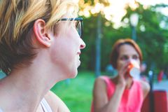 Two women talking in the park. Royalty Free Stock Photography