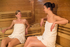 Two women talking in the sauna Stock Photography