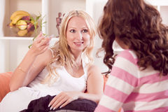 Two Women Talking Together Stock Photo