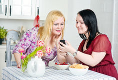Two women talking using telephone Stock Photo