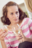 Two women talking with wine glasses Stock Photo