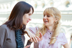 Two women talking. Two young women talking outdoors Royalty Free Stock Image