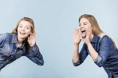 Two women telling tales, rumors gossip stock photos