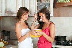 Two  women testing soup Royalty Free Stock Photography