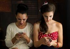 Two women texting. Stock Photo