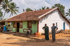 Two women and their house, Nilavagilukaval Karnataka India.