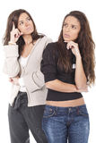 Two women thinking Stock Images