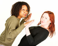Two women touching palms at angle Royalty Free Stock Images