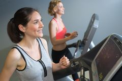 Two women training in gym Stock Photography