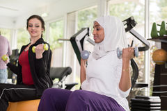 Two Women are Training in Gym Royalty Free Stock Photos