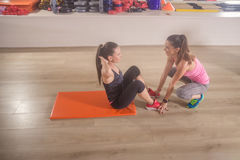 Two women training instructor abs workout gym Stock Images