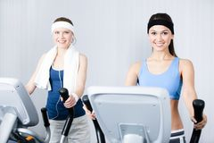 Two women training on training apparatus in gym Royalty Free Stock Photo