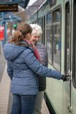 two women at tram stop Royalty Free Stock Photography