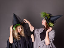 Two women treated costumes of witches Royalty Free Stock Images