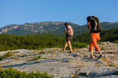 Two women is trekking Royalty Free Stock Image