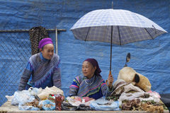 Two women under an umbrella at the market Royalty Free Stock Photos