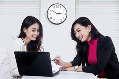 Two women using laptop in business discussion Stock Photography