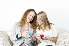 Two women using mobile devices Stock Photos