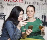 Two women using a smart phone. Stock Photos