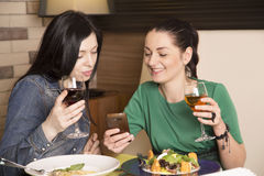 Two women using a smart phone. Stock Images