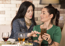 Two women using a smart phone. Stock Photo
