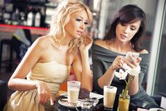 Two women using a smartphone Royalty Free Stock Photo