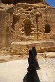 Two women with the veil niqab walking in Petra Stock Photography