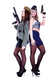 Two women in a vintage military uniforms with guns Royalty Free Stock Image