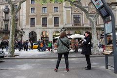 Two women wainting for the bus in Barcelona Royalty Free Stock Photography
