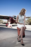 Two women waiting for a flight. Two beautiful women waiting for a pilot royalty free stock photography