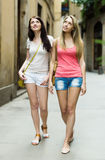 Two  women walking through ancient European city Royalty Free Stock Images