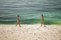 Two women walking on the beach Royalty Free Stock Photography