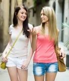 Two  women   walking through  European city Royalty Free Stock Image