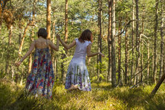 Two women walking in the forest Stock Photography