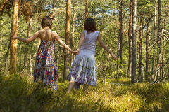 Two women walking in the forest Royalty Free Stock Image