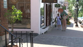 Two women walking in front of store stock video footage