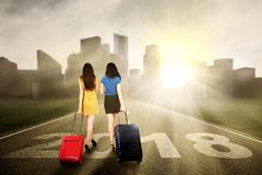 Two women walking on the road Royalty Free Stock Photography