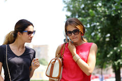 Two women walking in the summer city Royalty Free Stock Photography
