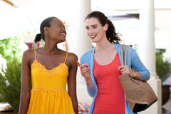Two women walking and talking outside Royalty Free Stock Photography