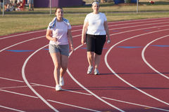 Two women walking a track Royalty Free Stock Photos