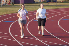 Two women walking a track Royalty Free Stock Image