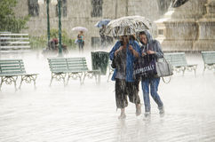 Two Women Walking under Umbrella during Heavy Rain Royalty Free Stock Photo