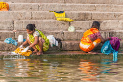 Two women washing clothes in the river Ganges Royalty Free Stock Image