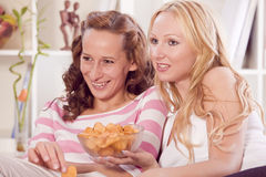 Two women watching television Stock Photos